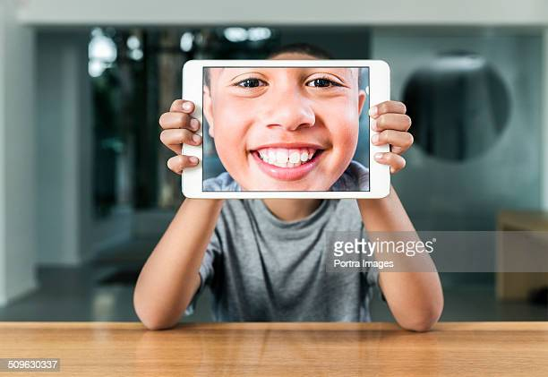 Happy boy taking self portrait