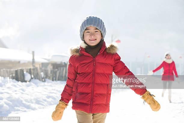 Happy boy walking in the snow