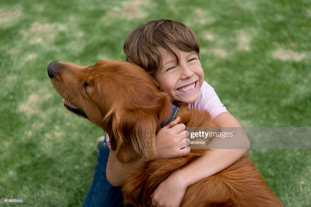 Happy boy with a beautiful dog : Stock Photo
