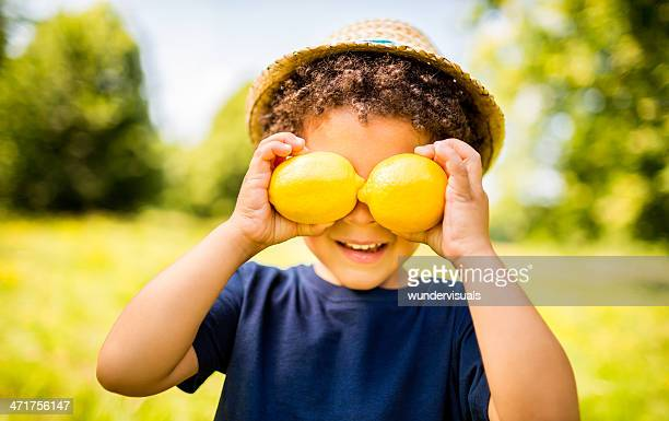 Happy Boy with lemons smiling as vitamin c concept