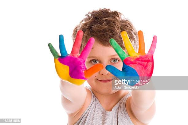 happy boy with painted hands