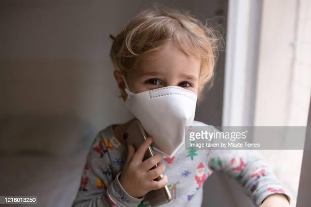 happy boy with smart phone and surgical mask - funny surgical masks stock pictures, royalty-free photos & images