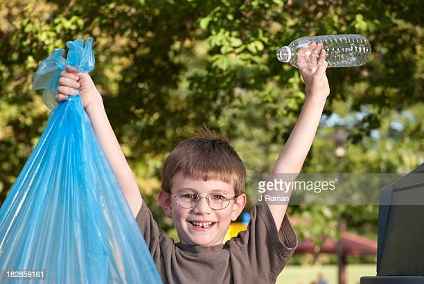 Happy Boy with Trash Held High