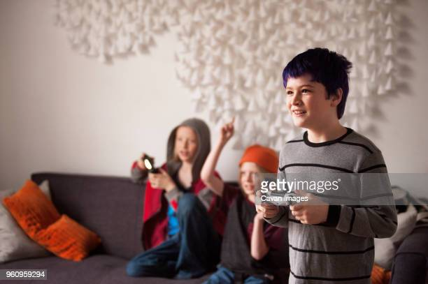 Happy boys playing video game at home