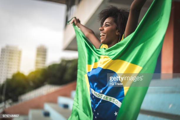 happy brazilian fan watching a soccer game - brasil stock pictures, royalty-free photos & images