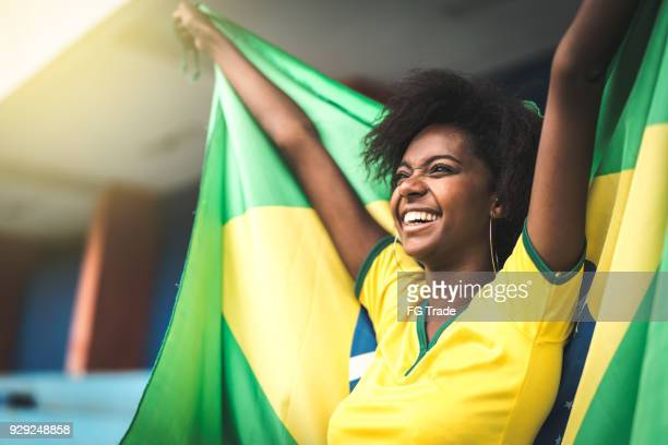 Happy Brazilian fan watching a soccer game