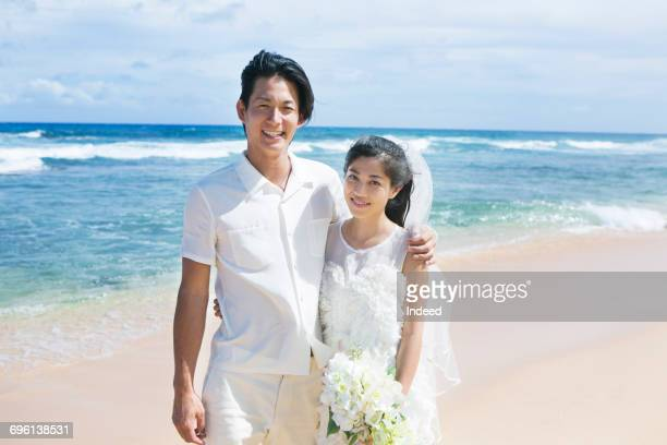 Happy bride and groom at beach