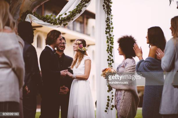 happy bride and groom getting married at outdoors wedding ceremony - wedding vows stock pictures, royalty-free photos & images