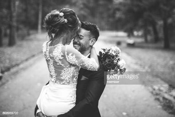 happy bride and groom in black and white - newlywed stock pictures, royalty-free photos & images
