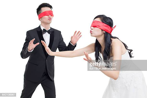 happy bride and groom playing game together - blindfolded bride stock pictures, royalty-free photos & images