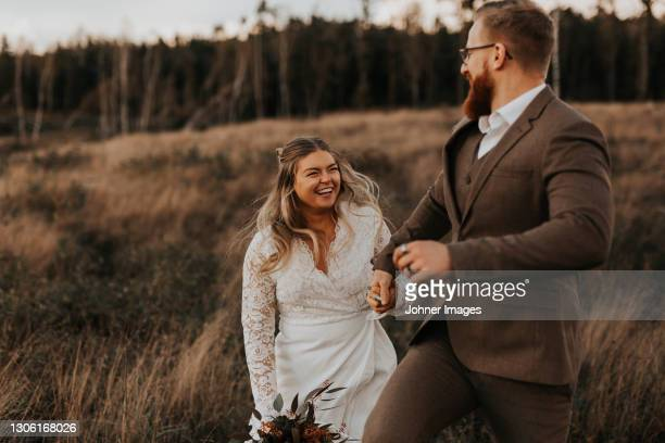 happy bride and groom together - formal stock pictures, royalty-free photos & images