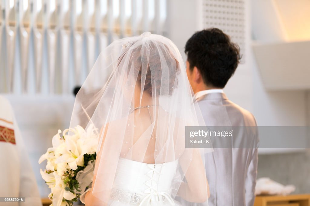 Happy bride and groom walking on virgin load : Stock Photo
