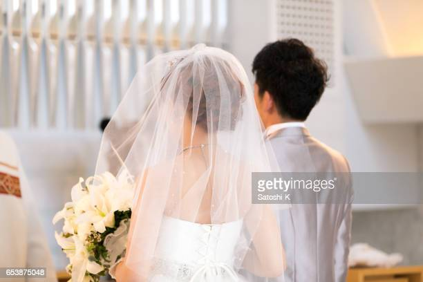 happy bride and groom walking on virgin load - wedding ceremony stock photos and pictures