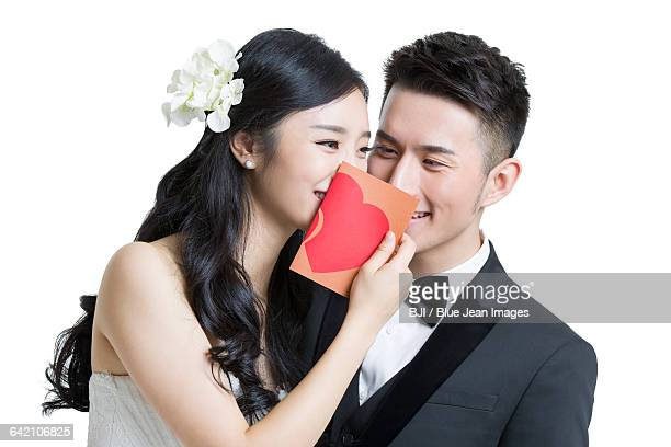 Happy bride and groom with love letter
