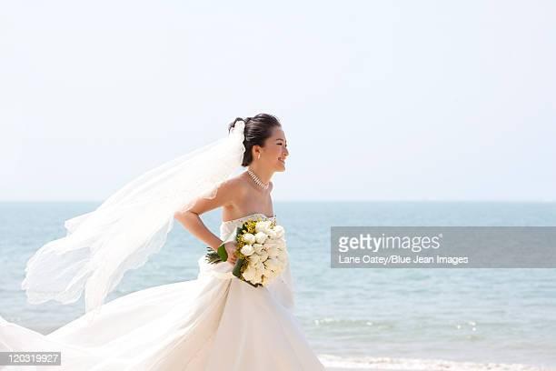 Happy Bride Running on the Beach