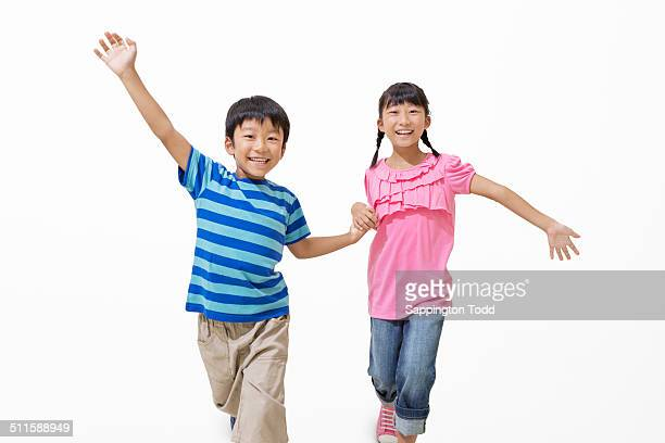 happy brother and sister - 姉妹 ストックフォトと画像