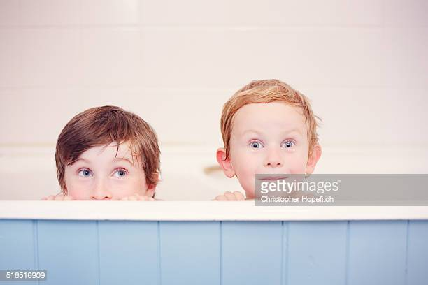 Happy brothers at bath time