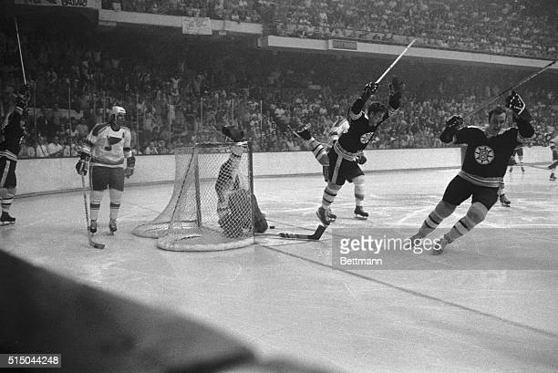 A happy Bruins' Bobby Orr whoops it up after scoring the winning goal in overtime period May 10 to give the Boston Bruins a 43 win over the St Louis...