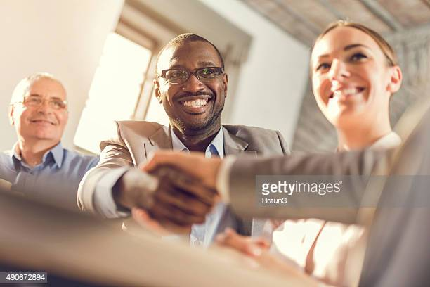 Happy business colleagues come to an agreement in the office.