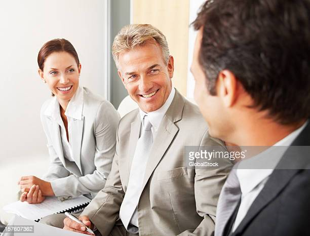 Happy business colleagues having a discussion in office