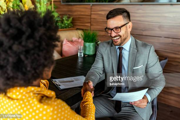 happy business colleagues in modern office - bonding stock pictures, royalty-free photos & images