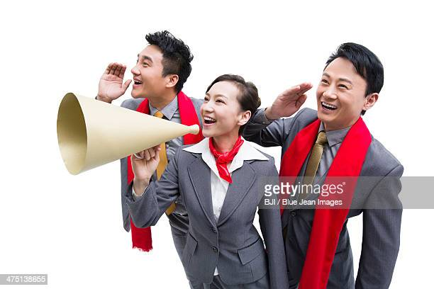 Happy business colleagues with megaphone