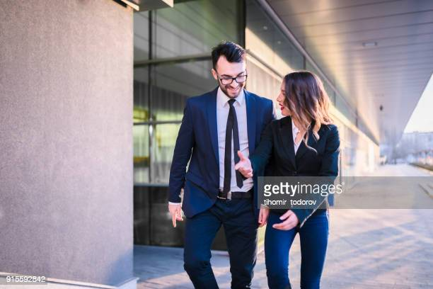 Happy business couple walking up the stairs