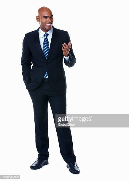 Happy business man giving a presentation against white