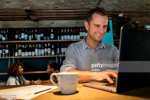 Happy business man working at a cafe