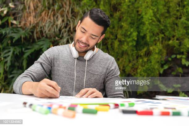 Happy business man working at a creative office