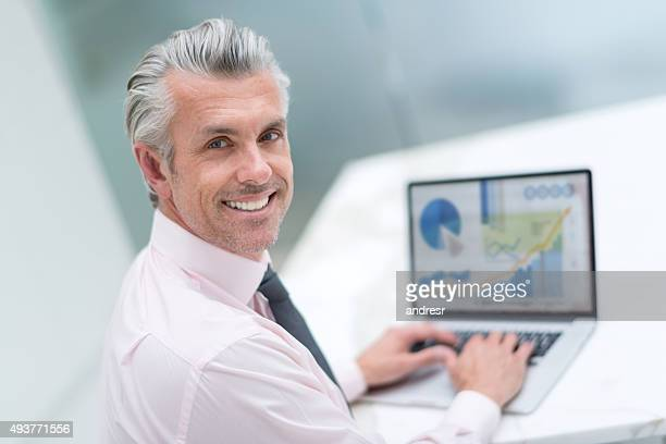 Happy business man working online