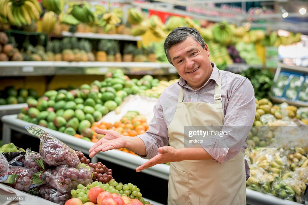 Happy Business Owner At A Food Market Stock Photo - Getty Images