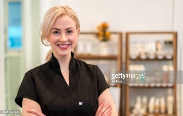 happy business owner working at a spa - beauty care occupation stock photos and pictures