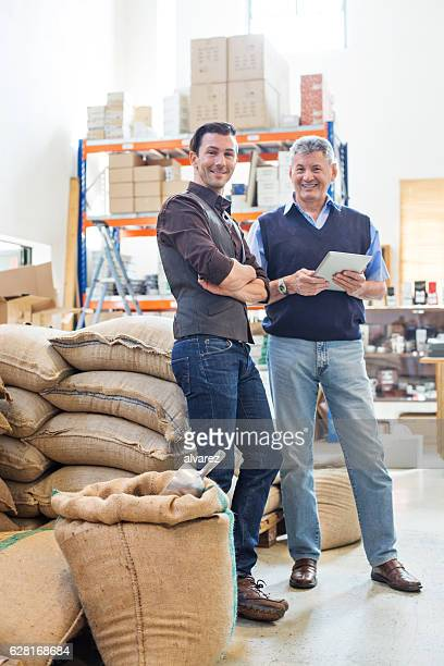 Happy business partners at coffee storage room