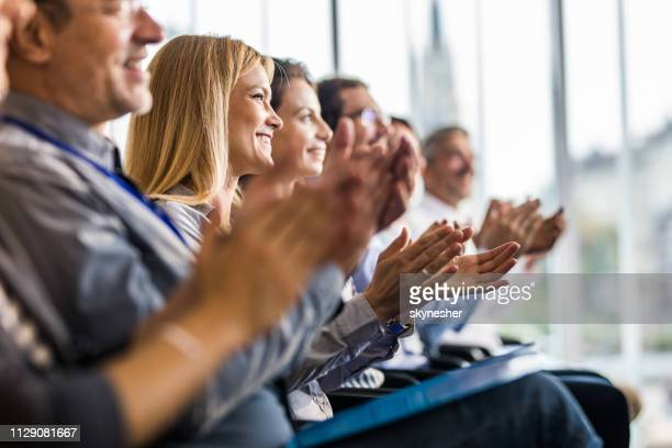 happy business people applauding on a training class in the office. - attending stock pictures, royalty-free photos & images