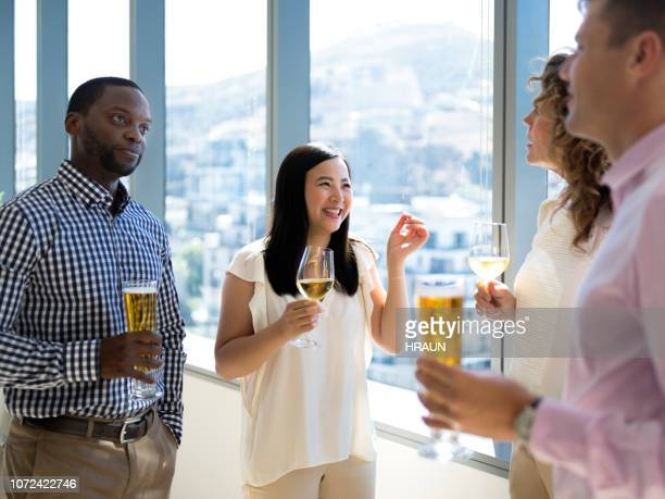 happy business people enjoying drinks after conference. - after party man stock pictures, royalty-free photos & images