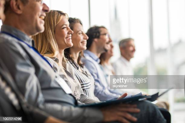 happy business people in a line on a training class in the office. - conference stock pictures, royalty-free photos & images