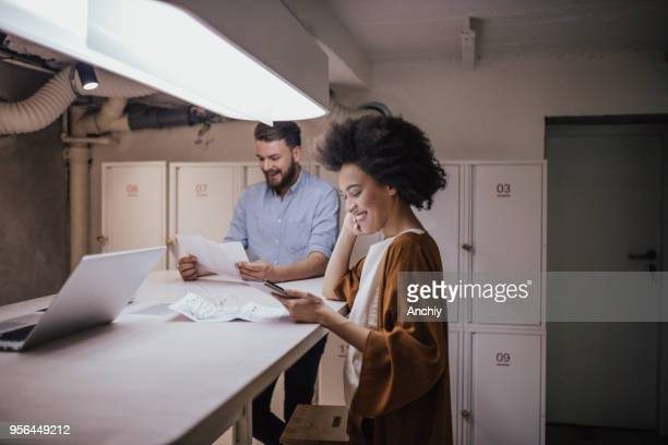 happy business people looking at documents - ginger banks stock pictures, royalty-free photos & images