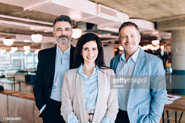 happy business people portrait - three people stock pictures, royalty-free photos & images