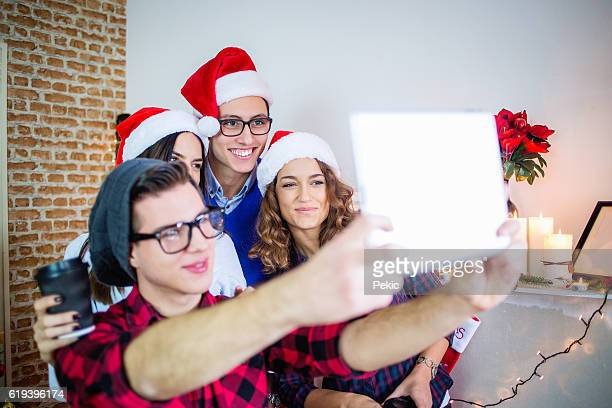 Happy business people posing for selfie on Christamas Time
