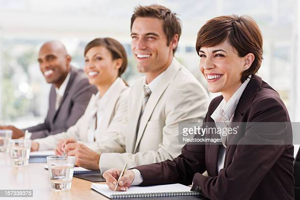 Happy business team at a meeting