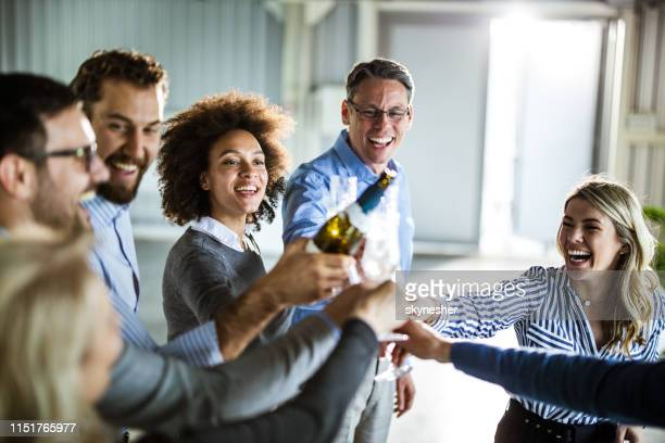 happy business team toasting with champagne at office party. - work party stock pictures, royalty-free photos & images