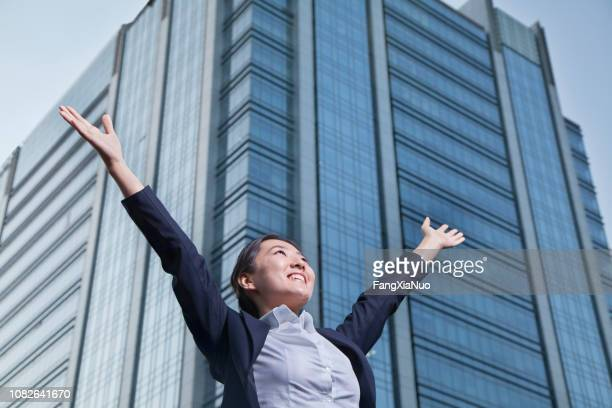 happy business woman raising hands - east asian ethnicity stock pictures, royalty-free photos & images
