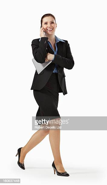 Happy business woman running whilst on smart phone