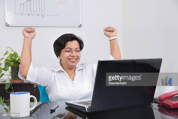 Happy business woman throwing up her arms with Joy