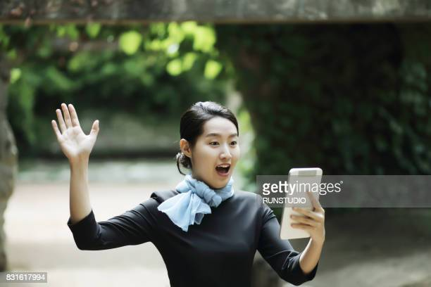 happy  business woman using tablet pc in the park.