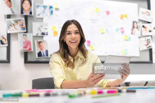 Happy business woman working online at a creative office