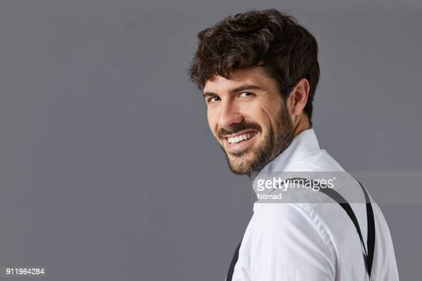happy businessman against gray background - suspenders stock pictures, royalty-free photos & images