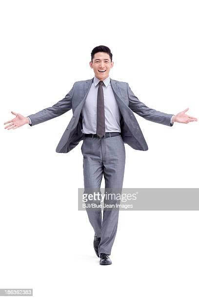 Happy businessman arms open