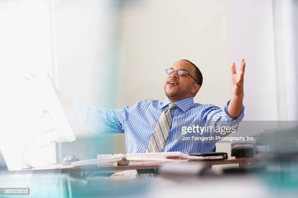 Happy businessman at desk